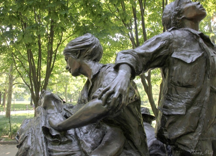 "Vietnam Women's Memoria ""While one nurse comforts the soldier, another kneels in thought or prayer. The third looks to the skies - for help from a medevac helicopter, or perhaps from a higher power."" Photo: TongMai"